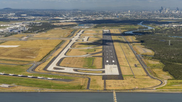 The new stretch of tarmac will be Brisbane Airport's third runway, but an existing one (bottom left) has been clogged by parked Virgin Australia aircraft in recent months.
