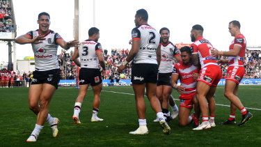 Man of the match: Roger Tuivasa-Sheck celebrates after the Dragons are denied a match-winning try in round 21.