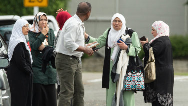 Families seen outside a mosque following a shooting at the Masjid Al Noor mosque in Christchurch.