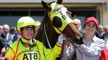 Meanwhile, at Sandown: Craig Williams returns to scale on Yogi, a winner for part-owner Cameron Percy.