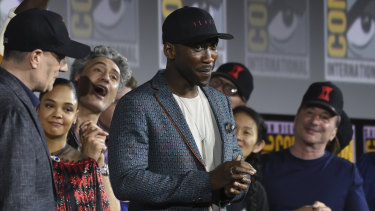 Mahershala Ali wears a hat to promote his upcoming role as Blade, the vampire hunter.