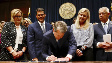 Georgia's Republican Governor Brian Kemp signs legislation on Tuesday.