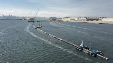 The Ocean Cleanup, a long floating boom that will be used to corral plastic litter in the Pacific Ocean is assembled in Alameda, California.