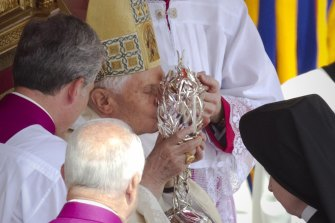 Pope Benedict XVI kisses the glass reliquary containing the blood of late Pope John Paul II, during the  beatification ceremony at the Vatican in 2011. The object has been stolen from a church in Spoleto, Italy.