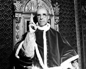 Pope Pius XII, wearing the ring of St Peter, sits on his throne at the Vatican in this September 1945 photo.