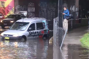 A driver has had to escape their car in Dudley Street on Friday morning after becoming caught in storm water .
