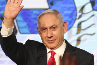 In this Wednesday, March 24, 2021, file photo, Israeli Prime Minister Benjamin Netanyahu waves to his supporters after the first exit poll results for the Israeli parliamentary elections.