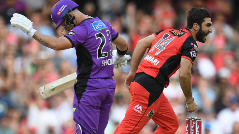 Mohammad Nabi of the Renegades, right, reacts after dismissing the Hurricanes' D'Arcy Short.