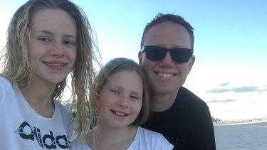 Tyson Bansagi is pictured with his two daughters. He had solar panels installed by Space Solar last month.