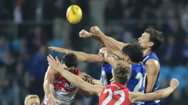 On the mark: The Swans and Kangaroos contest the ball at Blundstone Arena.