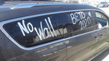 "Elisa O'Callaghan, a refugee activist from Dallas, painted ""no wall"" onto her car and drove for 10 hours to protest Trump's rally in El Paso."