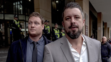 Rick Turner (left) and Neil Erikson leave the Melbourne Magistrates Court on Friday.