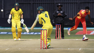 Short stay at the crease: Alec Carey gets the ball away against Zimbabwe at Harare Sports Club.