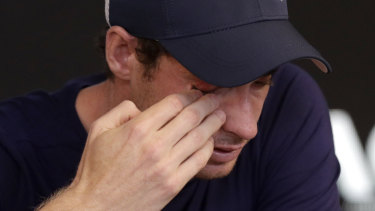 Andy Murray wipes tears from his face.