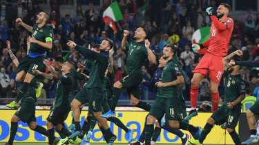 Italy celebrate their qualification after beating Greece in Rome.