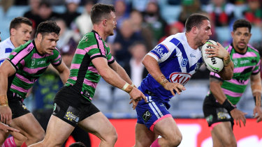 Off the leash: Adam Elliott of the Bulldogs breaks free of the Bunnies' defence.