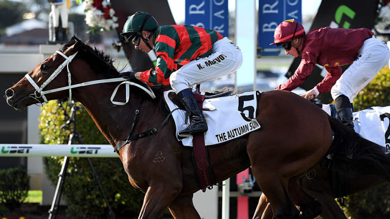 Stable quinella: The Autumn Sun gets the better of Zousain in the JJ Atkins at Doomben.