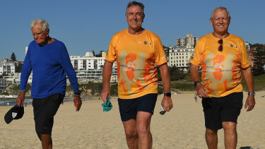 Another year, another run: Charles Rochesterleft, Chris Edwards, centre, and Ted Thompson walk along  Bondi Beach.