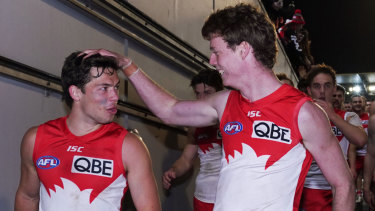 Young Swans Oliver Florent (left) and Nick Blakey celebrate the big win over the Demons.