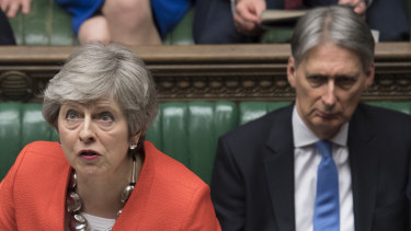 British Prime Minister Theresa May speaks in Parliament on Tuesday when her bid for an orderly exit from the European Union was defeated again.