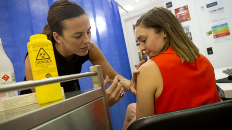 Pharmacist Jane Mitchell administers the flu shot at Ascot Vale Pharmacy.