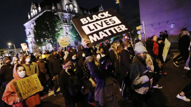 Protesters march in downtown Columbus.