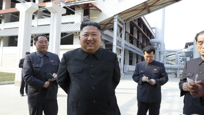 A golf cart, a white stick: New Kim Jong-un photos hold clues to mysterious absence