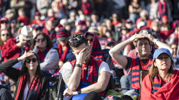 Despair at Fed Square: Subdued Dees fans view Eagles clash