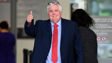 Businessman Clive Palmer gestures as he leaves the Supreme Court in Brisbane on Tuesday.