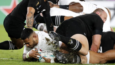 Unstoppable: Manu Tuilagi crashes over early to gain an ascendancy England never relinquished.