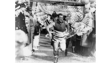 Footscray's captain Charlie Sutton leads the team out.