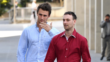 Luke Appleton (left) and Hayden Buchanan, who are friends of Alex McEwan, leave the Brisbane Supreme Court.  Two of McEwan's friends testified that violence was out of his character.