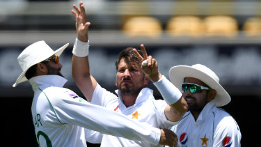 Bragging rights: Yasir Shah celebrates taking the wicket of Steve Smith.
