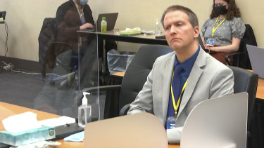 Former Minneapolis police officer Derek Chauvin listens as his defence attorney Eric Nelson gives closing arguments in his murder trial.