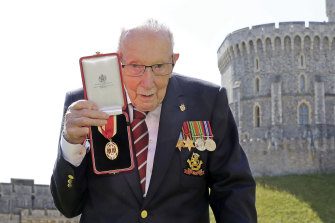 Sir Tom Moore after being knighted by the Queen.