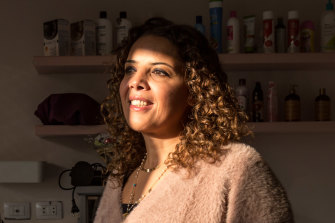 Ghada a-Hindawy, who opened a salon specialising in curly hair after researching treatments for her daughter's hair, at her salon, G Curls, in Cairo, Egypt.