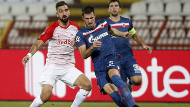 Red Star's Milos Degenek (right) duels with Salzburg's Munas Dabbur in the first leg.
