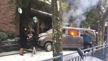 A van hit pedestrians outside a Starbucks cafe in Shanghai's popular Huangpu District.