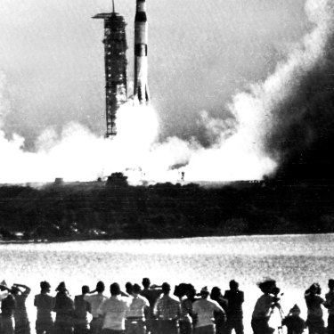 Members of the media and public watch as Apollo 11 blasts off, in this picture published on the front page of The Sydney Morning Herald in 1969.