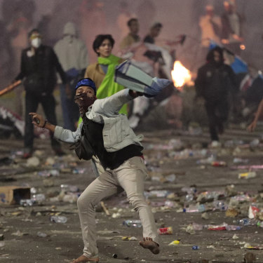 Protesters threw rocks at police and army on the streets of Jakarta.
