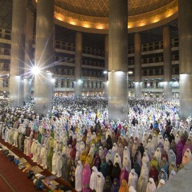 Muslims in Jakarta's Istiqlal Mosque perform the Tarawih evening prayer for Ramadan.