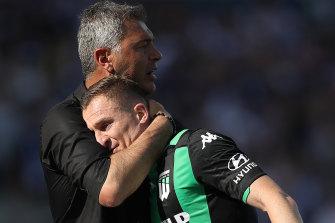 Mark Rudan hugs Besart Berisha after the striker was substituted off against Victory.