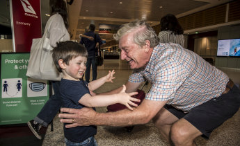 Alan Kinkade being greeted by Tom for the first time in months at Sydney Airport on Monday.