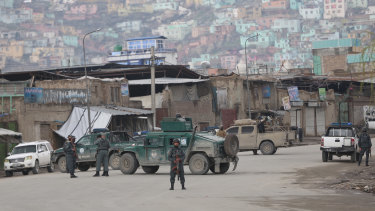 Afghan police arrive at the site of an attack in Kabul, Afghanistan.