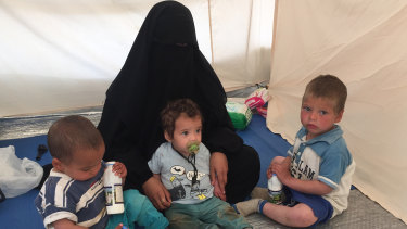 Australian woman Shayma Assaad, 19, and her three sons in her tent at the al-Hawl camp in north-eastern Syria. She is the wife of Mohammed Noor Masri, another Australian who went to live with Islamic State and is now detained separately from his wife.