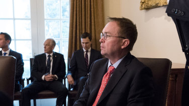 Mick Mulvaney, the acting White House Chief of Staff and director of the Office of Management and Budget, looks on as President Donald Trump speaks during a meeting in the Cabinet Room of the White House in Washington in January.