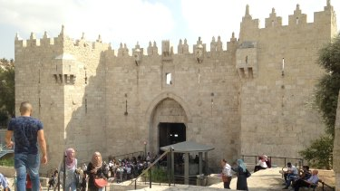 The Damascus Gate entrance to Jerusalem's Old City. The grey metal structure on the right is an Israeli police post.