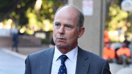 Former IOOF chief executive Chris Kelaher leaves Federal Court.