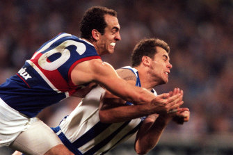 Wayne Carey and Matthew Croft fight for the ball.