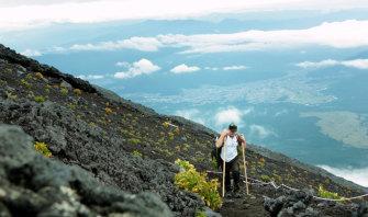 Leigh Conkie climbing Mount Fuji in Japan.